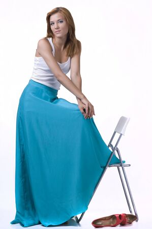 long skirt: Portrait of a  beautifulgirl in a long skirt on a white background Stock Photo