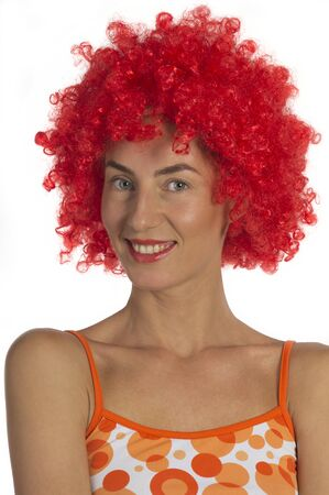 A young beautiful woman in an orange wig on a white background.