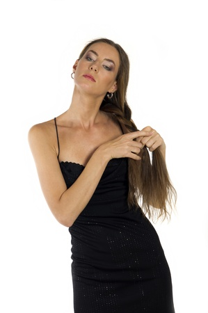 Young beautiful woman in evening dress with long hair on a white background 版權商用圖片