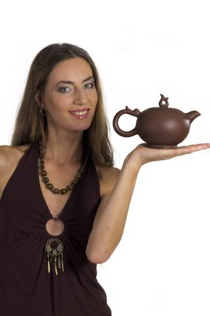 A young beautiful woman with  Kettle  in hands with long hair on a white background Stock Photo - 10608623