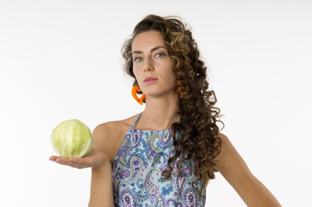 Portrait of a young beautiful woman in a blue dress with an cabbage in his hand photo