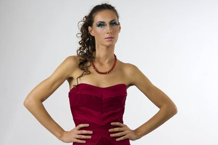 Portrait of a young beautiful woman in a red dress with bright makeup Stock Photo - 13556961