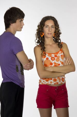 A girl and a young sporty guy are side by side. A guy looks at the girl. photo