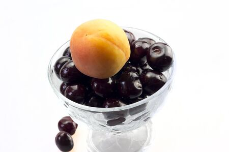 Apricot and cherries on a plate closeup
