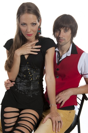 Young couple in love in the Studio, a girl sits on a guy's hands photo