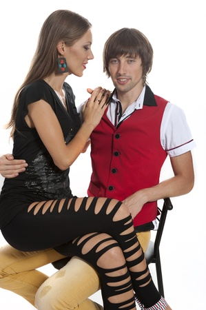 Young couple in love in the Studio, a girl sits on a guys hands photo