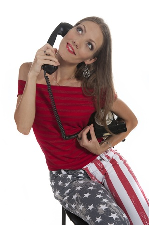 Young beautiful woman with an old phone in your hands photo