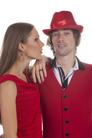 Young couple in red, white and black in the studio on a white background photo