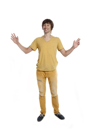 A young man in the yellow tee shirt on a white background in the studio. Stock Photo - 14188892