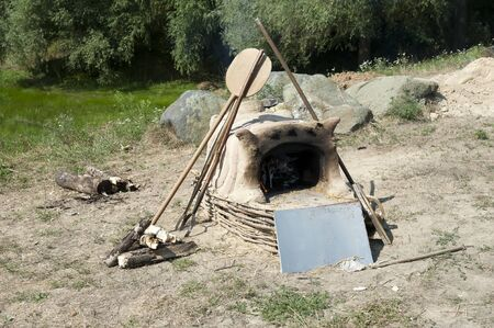 Antique traditional clay Ukrainian stove outdoors