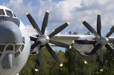 turboprop: Turboprop transport aircraft against the blue sky closeup Stock Photo