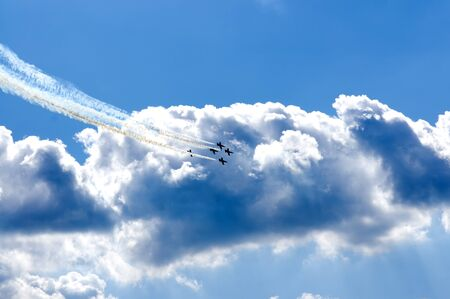 without clouds: Performing aerobatics in aircraft in the blue sky without clouds Stock Photo