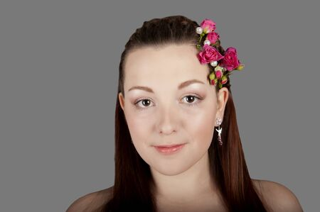 Portrait of a young beautiful woman with flowers in her hair Stock Photo - 18203358