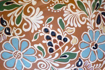 Traditional Ukrainian ornament on the clay platel closeup