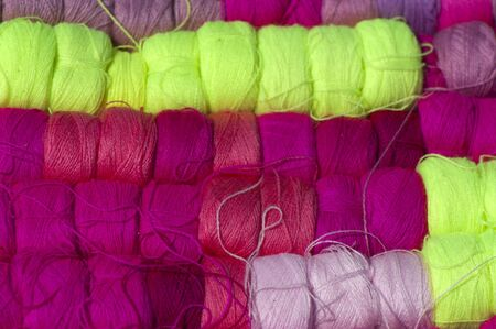 Colored wool yarn in coils closeup, background Banco de Imagens