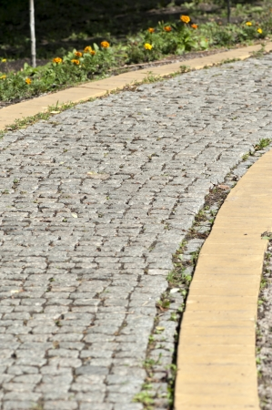 pavers: Garden path of pavers in the summer in sunny day Stock Photo