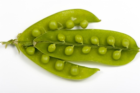 Green peas, legumes close up on a white background