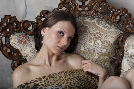 Portrait of a young woman in a pretty easy chair photo