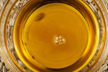 Sunflower oil and seeds of sunflower closeup Banco de Imagens
