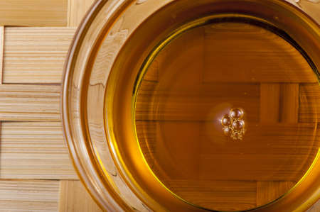Sunflower oil in a glass cup close up