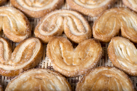 Sweet puff pastries on a napkin, close up