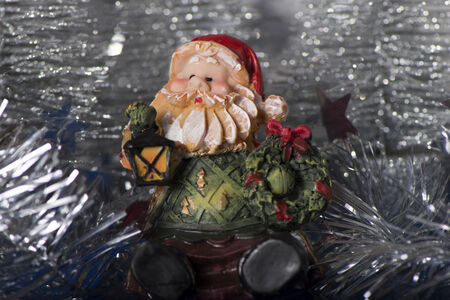 Toy Gnome with lantern and festive Christmas wreath Banco de Imagens