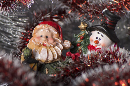 Toy Gnome with lantern and festive Christmas wreath and Snowman Banco de Imagens