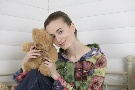 Portrait of a young woman in an interior children s room photo