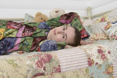 Young woman in the children bedroom  photo