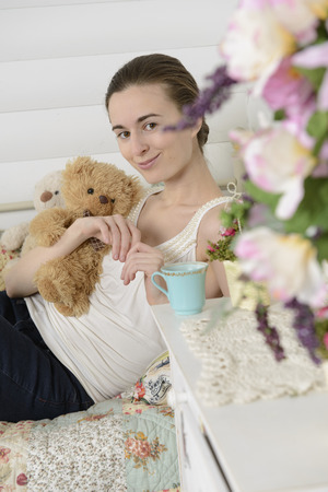 Portrait of a young woman in an interior children photo