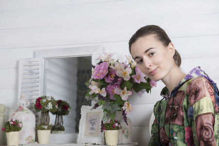 Portrait of a young woman in an interior children's room Imagens - 25953210