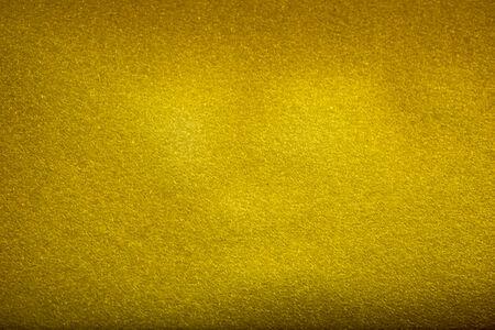 Yellow golden structural foam plastic background