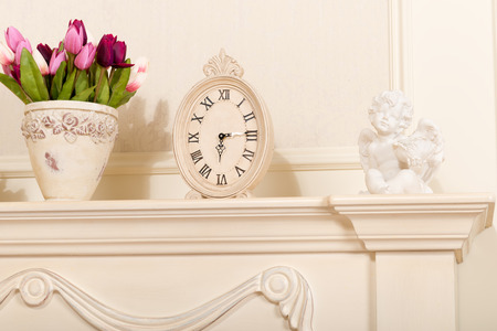 mantel: Old mantel clock with a candlestick in the form of an Angel