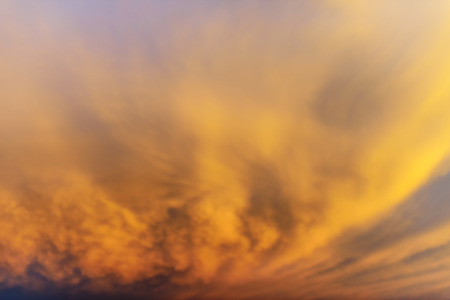 Background of the sky at sunset with clouds of brown, soft focus