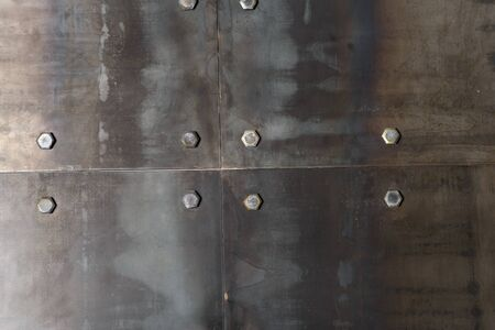 metal structure: Background of the metal plates, bolted to the wall