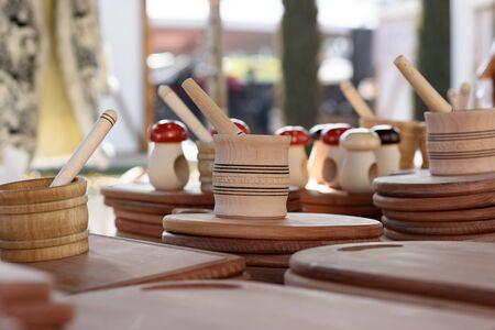 street vendor: Wooden kitchen utensils on the counter of a street vendor