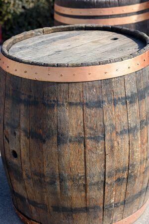 Wooden open empty wine barrel in the sun Stock Photo