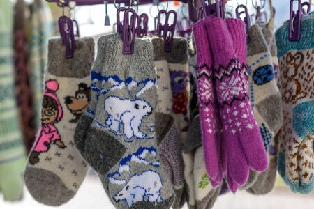 street vendor: Wool knitted socks and gloves on the counter of a street vendor