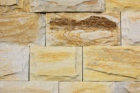 Background of natural building stone treated Stock Photo