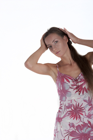 Portrait of a young beautiful brown-haired on a white background isolated