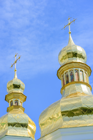 Golden Orthodox Christian crosses on the domes of the churches of Kievs Pechersk Lavra