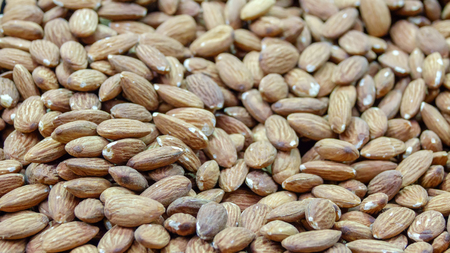 Peeled almond kernels closeup background Stock Photo