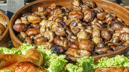 Grilled mushrooms champignons in a bowl close up