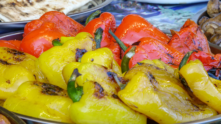 Grilled red and yellow peppers on the home on the stove close-up Stock Photo