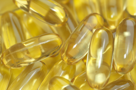 Soft gelatin capsules with omega-3 fish oil, ALA, EPA, dietary therapeutic food supplement Stock Photo