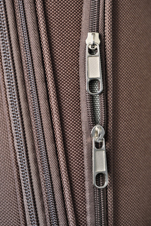 Brown background of dense synthetic fabric for suitcases with zipper Stockfoto