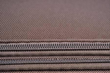 Brown background of dense synthetic fabric for suitcases with zipper Banco de Imagens