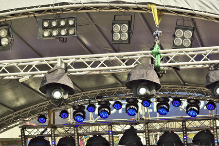 Outdoor stage lighting equipment with a tarpaulin rain cover
