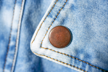 Blue denim background shot with shallow depth of field close-up macro 写真素材