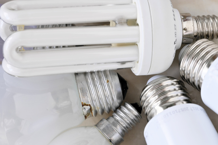 Lighting electric lamps for living rooms LED and incandescent bulbs close-up lie on the table Standard-Bild - 119916413